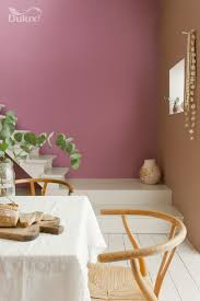 Open up your space with an impactful painted white floor that contrasts  with delicate peach and