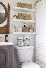 Shiplap Wall in master bathroom with Shelves Over Toilet