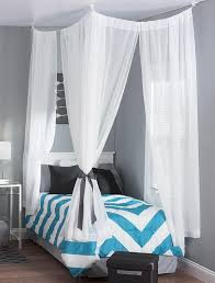 Sleep in style by adding this fabulous DIY canopy to your dorm room bed.