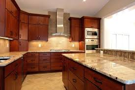 cherry cabinets with granite countertops photo of construction united states kitchen with a curved cherry cabinets with black granite countertops