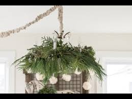 how to decorate a chandelier with fresh greenery for miss mustard seed you