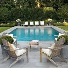 patio furniture layout ideas. grass grey stone paving gorgeous pool furniture and i love the potted flowers patio layout ideas l