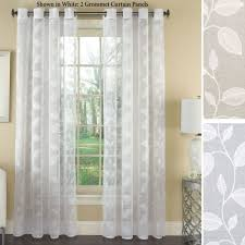 avery semi sheer embroidered grommet curtain panels avery grommet curtain panel to expand