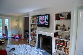 fabulous image result for hang tv above fireplace where to put cable box with tv mounted above fireplace where to put cable box