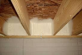 spray foam on outside wall between floor joists