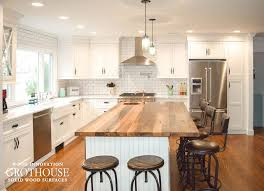 white subway tile with a reclaimed oak countertop
