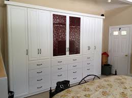 modern mirror closet and white master bed to look roomy of exotic large wooden wardrobe with agreeable design mirrored closet