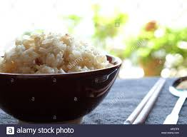cooked brown rice in a bowl. Brilliant Cooked Cooked Brown Rice In Bowl With Chopsticks And Spoon Place On Table  Selective Focus Throughout Brown Rice In A Bowl N