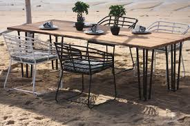 the exo teak outdoor dining set from patio ions