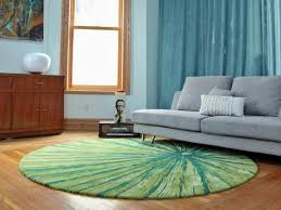 contemporary living room with fun green area rug