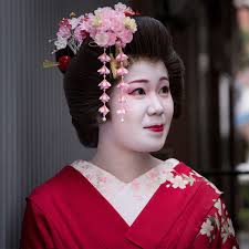 Japanese geisha girls  without their wigs  prepare themselves for the  evening  having their