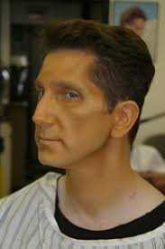 next i applied a mixture of my yellow base with that of a paler cake makeup this was applied to the high points of clayton s face to delineate the