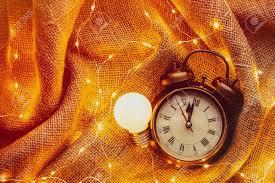 Bulb Fairy Lights Vintage Alarm Clock With Bulb And Fairy Lights Around On Jute