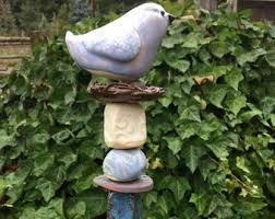 bird on a nest garden totem