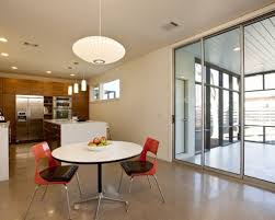 Great room - mid-sized contemporary concrete floor great room idea in  Austin with white