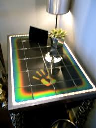 moving color also offers other styles of color changing glass including their interactive ceramic touch sensitive tile that can be used in furniture