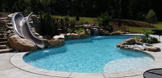 Backyard pool with slides Rectangular Fun In The Sun With Swimming Pool Slide Homeadvisorcom Swimming Pool Slides Prices Types Construction Installation