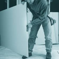 a man planing drywall construction pro tips