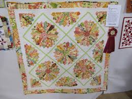 Sew Many Ways...: Quilt Show...Congratulations Tina!!! & The bottom one to the right is the Blue Ribbon Winner and my favorite  too...you know I love my hexagons!! Adamdwight.com