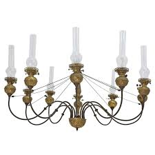 english victorian ten light chandelier in brass with glass chimneys circa 1870
