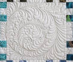 """Feather quilting – Ivory Spring & Joyce gave me her permission to coin the name """"Roundabout Feathers"""" for  these fun feather wreaths with a twist! These feathers are free-hand quilted  with ... Adamdwight.com"""