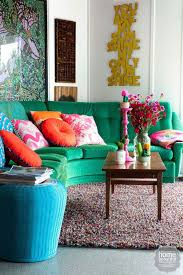 Image Fpl2011 Fashion Designers Love Of Bold Hues Colourful Prints And Quirky Art Pervades Every Corner Of Her Eclectic Beachside Home Green Sofa Jewel Tone Living Pinterest Fashion Designers Love Of Bold Hues Colourful Prints And Quirky