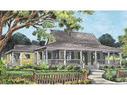 country acadian home design with wrap around porch