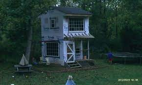 two story playhouse with swingset