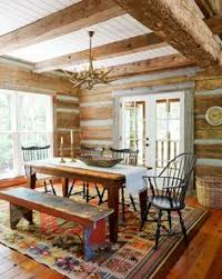 a mix of black windsors hand crafted by lawrence crouse work surrounds the farm table