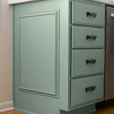 completed and painted faux panel prime the unfinished raised cabinet