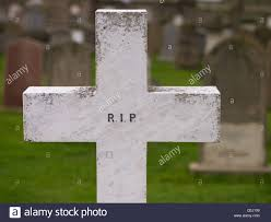 white cross gravestone with the letters rip CEJ109