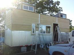 finishing up mounting the t1 11 siding after ing in the corrugated metal siding