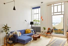 living roomwith beige rug orange plastic midcentury chair blue sofa wooden coffee table kia designs