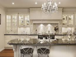 beauiful classic cabinet kitchen remodel luxury round crystal chandelier with decorative iron armchairs plus white kitchen set idea also black granite