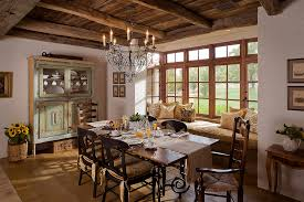 french farmhouse dining table dining room farmhouse with distressed paint window seat wrought iron chandelier