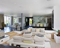 Trendy light wood floor living room photo in London with white walls, a two-