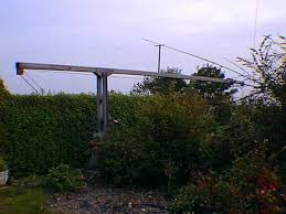 pic of tower tilted over so that the quad is at the other side of the hedge on the lawn