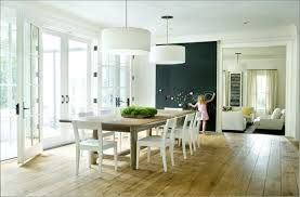 white dining room design with light maple floor and contemporary drum pendant lighting wood