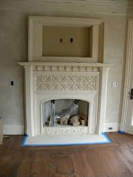cast stone fireplace mantels too ornate but like the tv feature built in