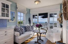 Small beautiful sunroom with white and aqua colors cottage theme and ocean  views