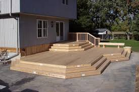 2-level, large deck with a bench and a built-in planter.
