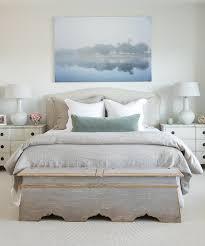 gray slipcovered headboard with gray linen bedding
