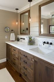 best lighting for bathroom vanity. an elegant oval mirror gives the linear bathroom a hint of curves satinnickel best lighting for vanity