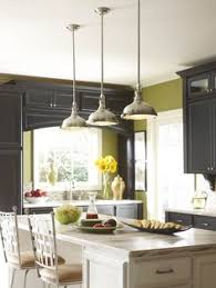 fixtures with an industrial flair support a great clean lined look for kitchen settings and are a strong trend for 2014 featuring progress lightings ashbury kitchen lighting