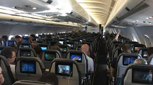 each seat has an individual headrest mounted entertainment system the screen was better than most economy seats i ve experienced bigger than that offered