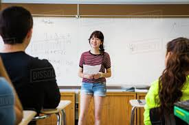 Student Presentation Female Student Giving Presentation In Front Of Class Whiteboard In