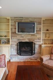 living room with stone fireplace with tv. Living Room With Stone Fireplace Tv E