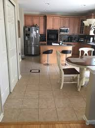 Help Flooring tile needs to be laid in two different directions