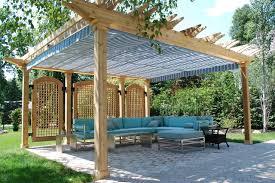 Traditional backyard patio idea in Toronto with a pergola
