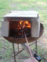 homemade brick forge. blacksmithing on a home made forg homemade brick forge